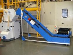conveyor with metal detection stop and alarm